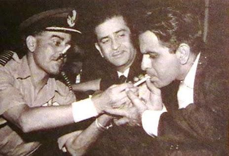 1960s :: Dilip Kumar Smoking As Raj Kapoor Looks on (@IndiaHistorypic) | Twitter