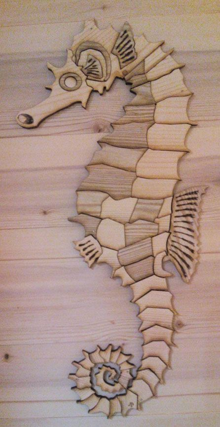 Seahorse made by laser cut in dead pine wood. Made by Laurent MARTIN, www.lebancfustier.fr