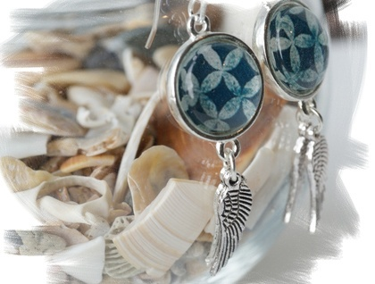 dangly silver pacifica earrings with angel wings