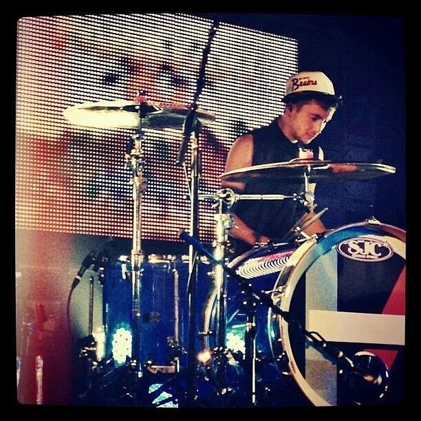 Tyler on the drums wearing a hat. Wait... where's Josh? Dammit Tyler, did you kick him out of the band again?