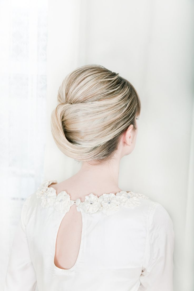 Sleek modern wedding updo with romantic lace wedding dress | OneWed.com