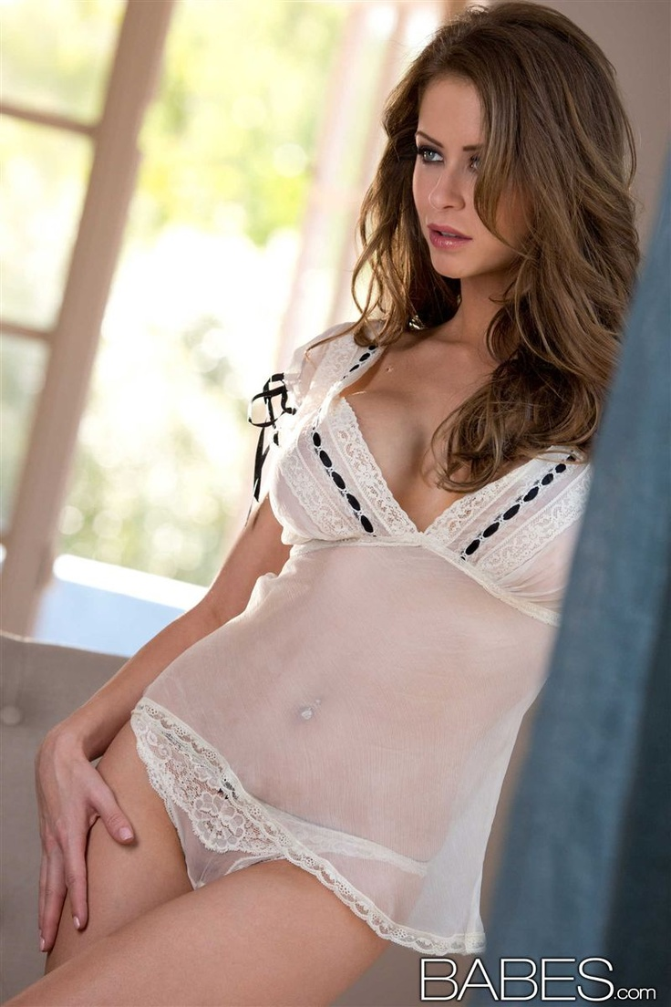 Emily Addison (@EmiAddison) poses in her sexy white sheer ...