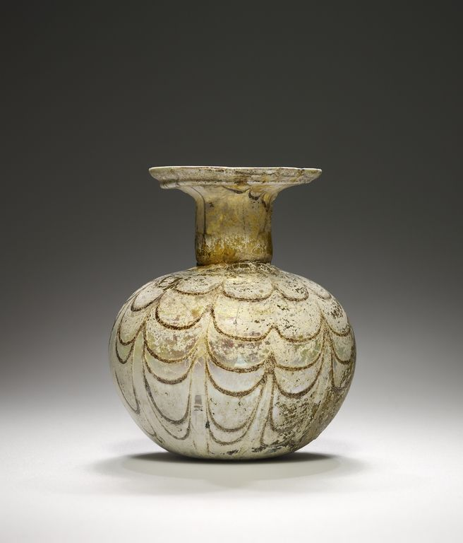 Sprinkler Flask.  Artist/Maker(s): Unknown.  Culture: Roman.  Place(s): Eastern Mediterranean (Place created).  Date: 3rd - 4th century.  Medium: Glass.