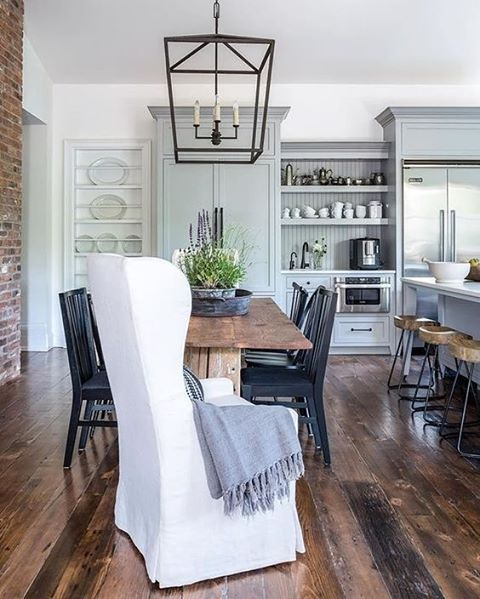 I like the mix of textures and colours in this room - brick wall, slipcovered chair with timber dining chairs, Iron lantern light and pale blue cabinetry. Image from Tumblr.