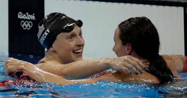 United States' Katie Ledecky, left, is congratulated by Britain's Jazz Carlin after winning the gold medal in the women's 400-meter freestyle setting a new world record during the swimming competitions at the 2016 Summer Olympics, Sunday, Aug. 7, 2016, in Rio de Janeiro, Brazil.