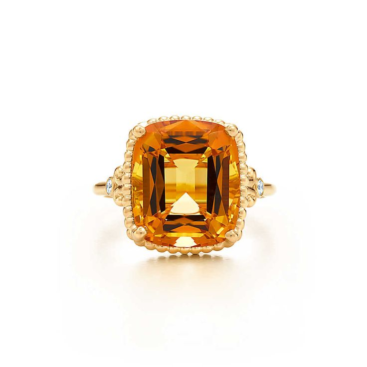 Tiffany Sparklers citrine ring in 18k gold with diamonds.  Love at first sight !