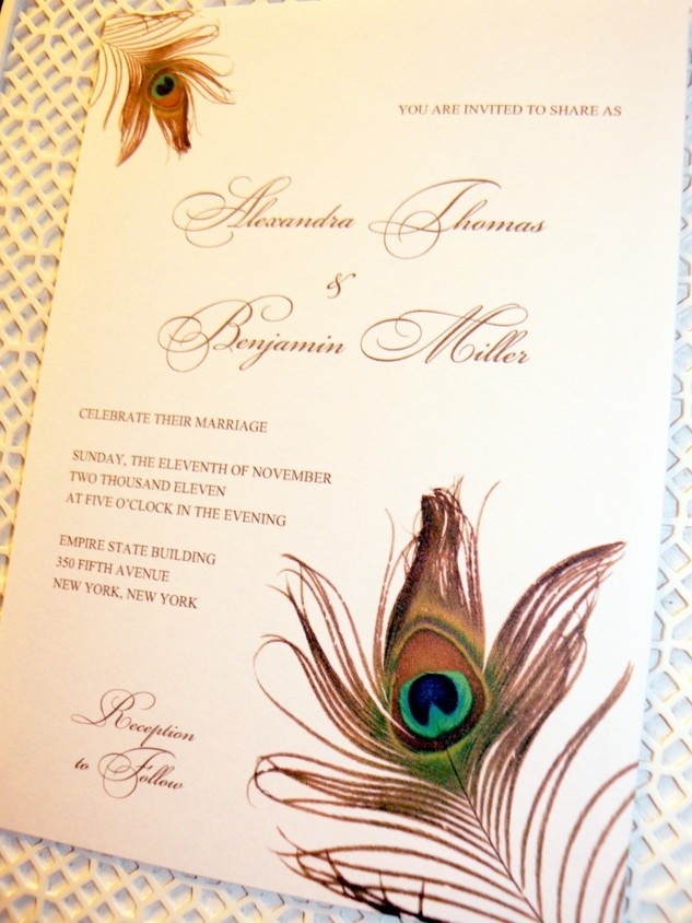 Gold Feather Wedding Invitations. Gracefully draped along the upper left and lower right edge of this wedding invitation, two exotic peacock feather create a festive and sophisticated look on this wedding invitation. Beautifully designed in shades of gold, teal, and royal blue. It's ideal for the bridal couple who have unique style. Would look fabulous with a gold layer or in a pocketfold.    Available at www.fanfaredesigns.etsy.com