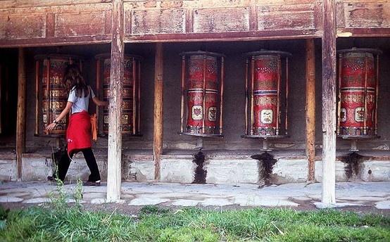 "Prayer Wheels :: ""Clockwise. Always clockwise. Clockwise round."" A prose poem of my spiritual experience of taking the pilgrim's path, turning the prayer wheels ringing the expansive Tibetan Buddhist monastery, Labrangsi, at Xiahe, Gansu Province, People's Republic of China."