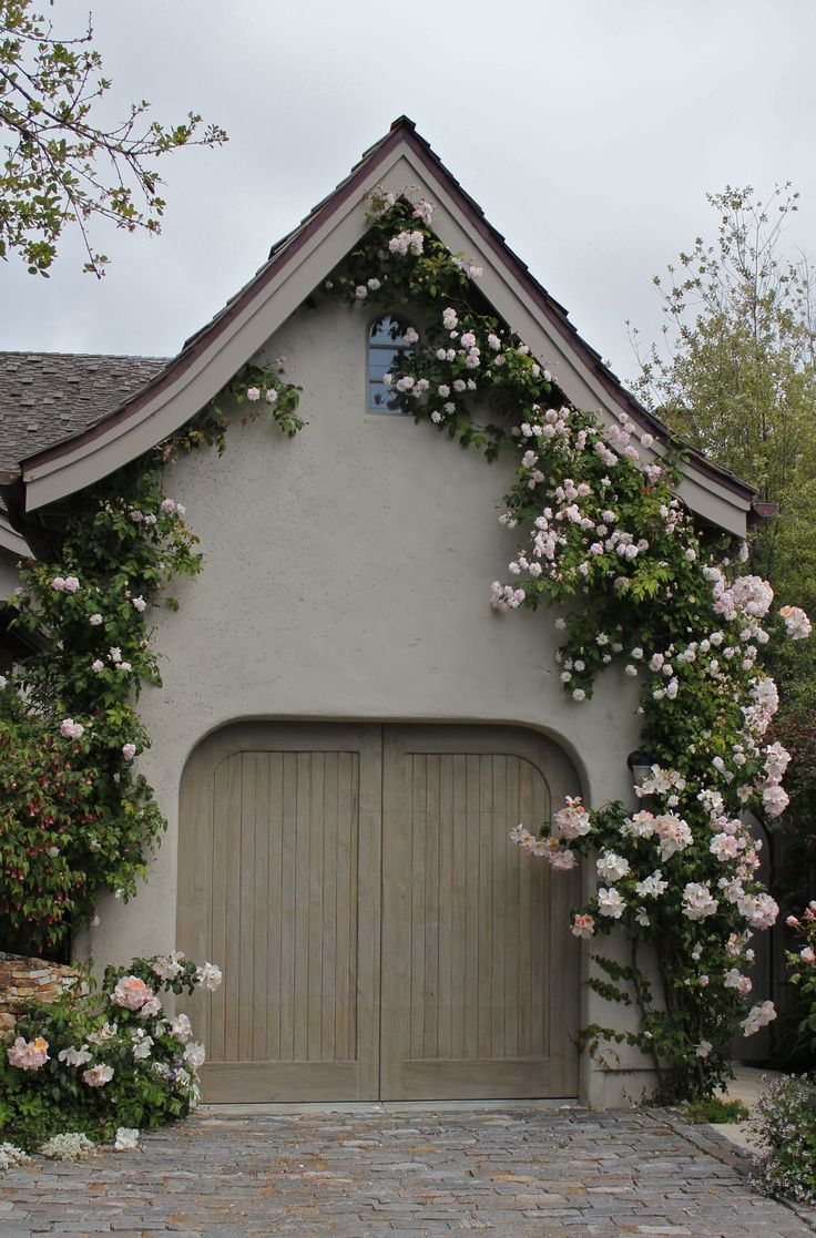 Climbing roses frame the garage