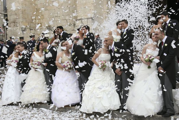 Noivas de Santo António  -  Brides of Saint Anthony. Every June 12th, the Town Council of Lisbon offers a wedding to the couples who have financial struggles. It has been a tradition in Portugal from many years now. :)