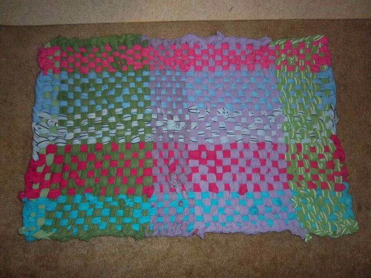 Potholder rag rug.. made with cotton t-shirts. Created by Amy Marie Hann