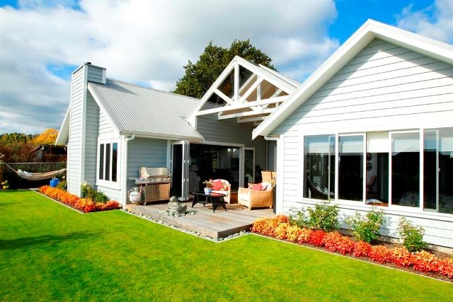 Superbly manicured gardens complement this custom-designed home in Nelson.