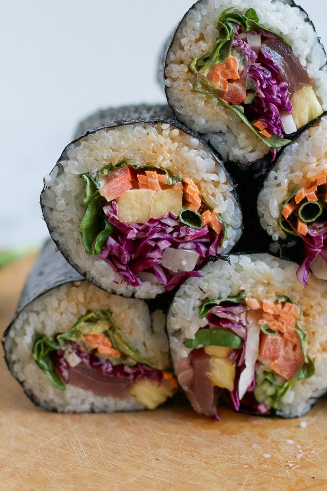 Sushi Burrito! A delicious twist on a burrito with sushi fillings! If you've never had a Sushi Burrito before, you are in for a treat! These are so easy to make and so delicious!! Just watch the video below!