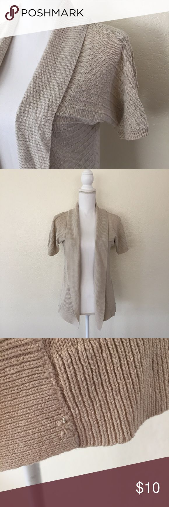 """Ann Taylor Short Sleeved Cardigan Short Sleeve Beige Open Cardigan by Ann Taylor in Size XS A neutral cardigan perfect for work. Good condition except for small hole on bottom left. Please see pictures for more details.  Approximate Flat Measurements Bust 17"""" Length 24.5"""" Ann Taylor Sweaters Cardigans"""