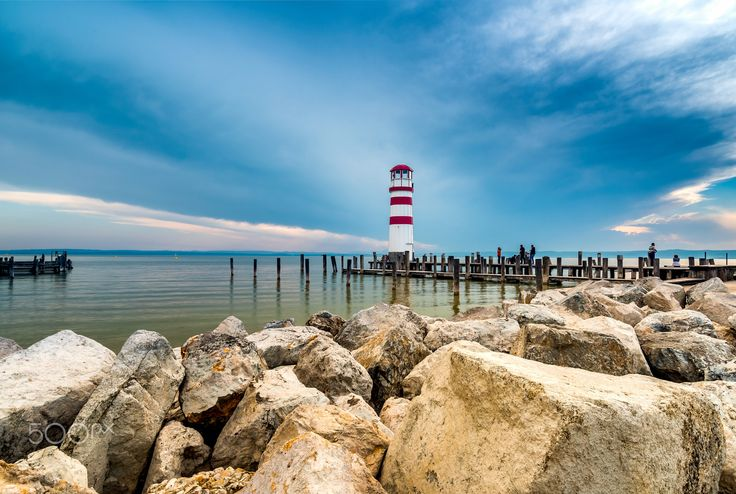 Lighthouse at the lake II - View to the piers at the Neusiedler See with its famous lighthouse in Podersdorf am See in Austria.