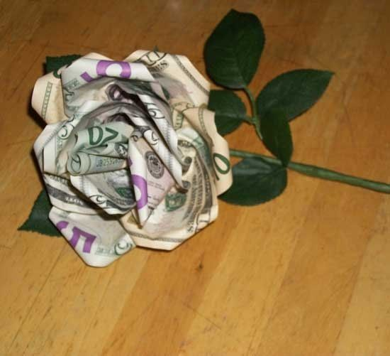 How to turn paper bill into a money flower.  I remember a HS student recieving 16 money roses on her 16th birthday.  I always wanted to learn how to make these.  No money was injured in the making of a flower.  Money was only folded and pinched.