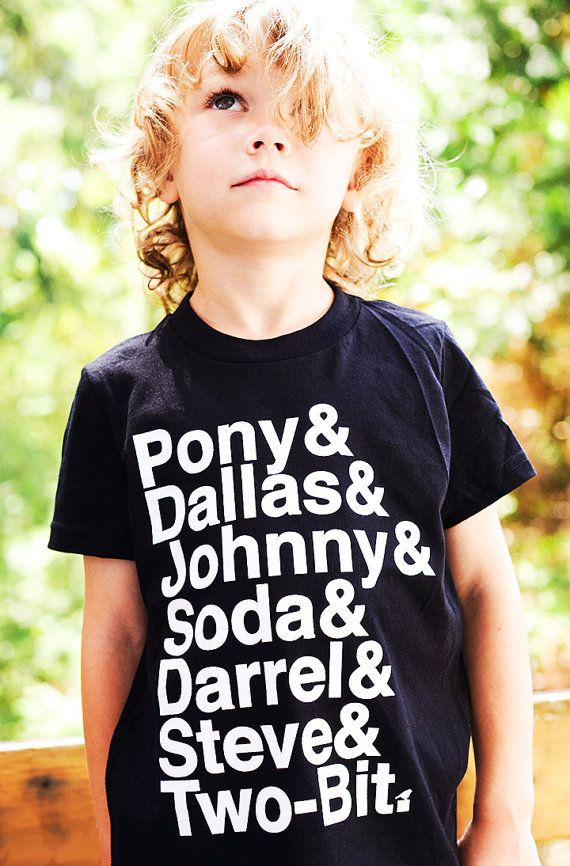 A tee shirt with the character names from The Outsiders, written S. E. Hinton
