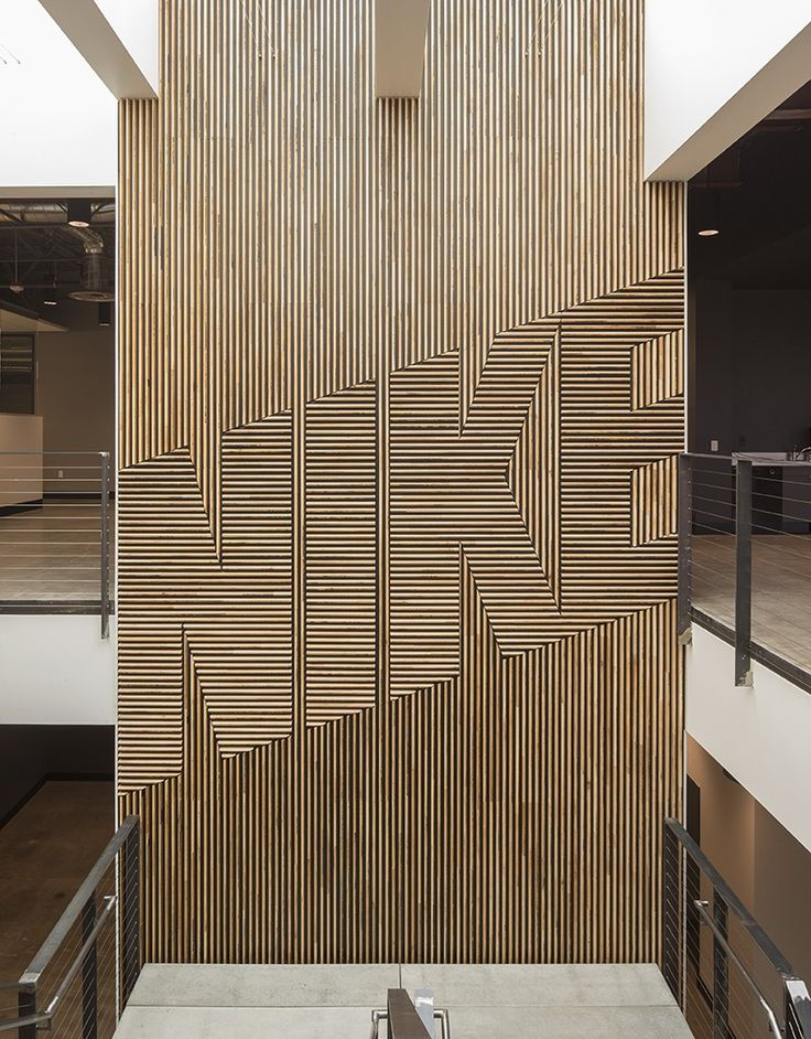 wood NIKE feature wall - it's not 'what' it says, but the fact 'that' it says…