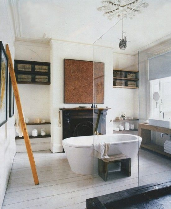 Ultimate luxury... taking a bath by a fire.  Love how this feels like any other room with the shelves, fireplace, artwork and wood floors, but is also just a bathroom!