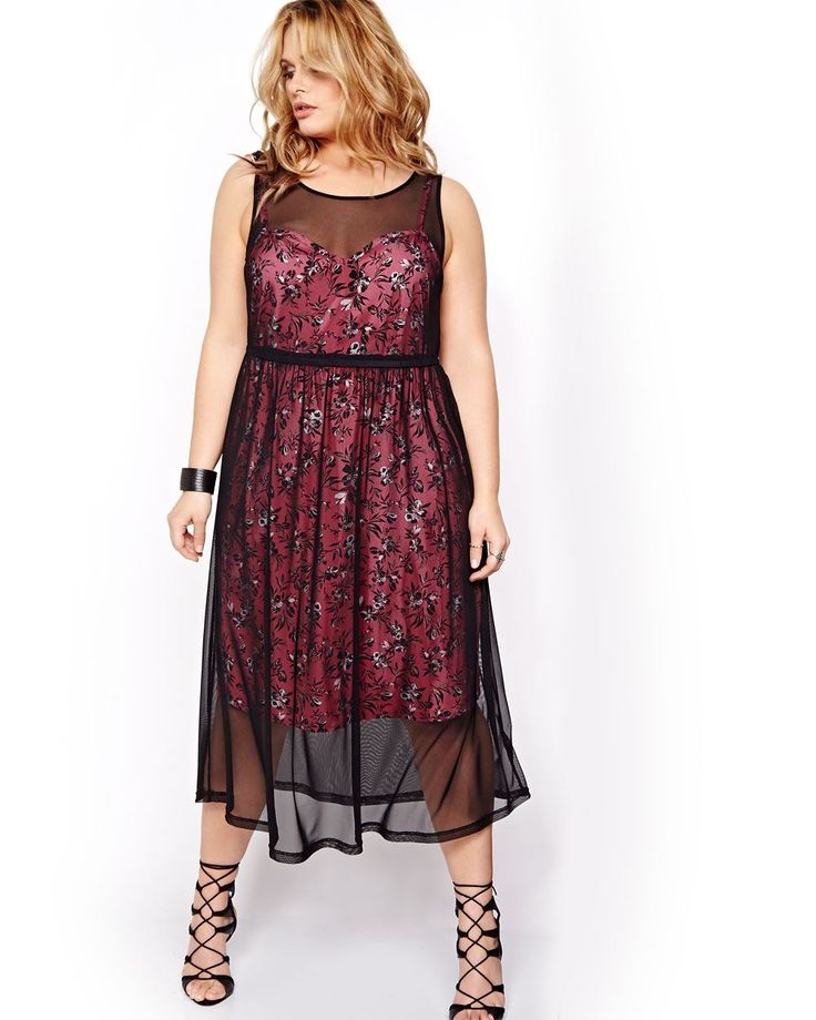 This plus size dress from the Love & Legend collection is definitely an original. Mixing a long mesh lining with a short printed bustier-style dress, it will turn heads everywhere you go. Sleeveless, keyhole back, adjustable straps. 46 inch length.