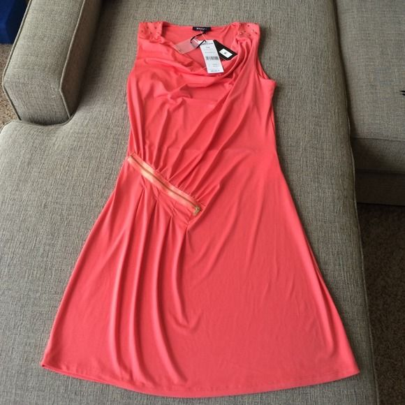 Coral Dress by French clothing brand Morgan Beautiful coral dress with drape neck and studded shoulder details. Gathered at the waist with a faux zipper. Sure to be the only of it's kind at any event. 92% polyester 8% elastic. Fitted and flirty! Morgan Dresses