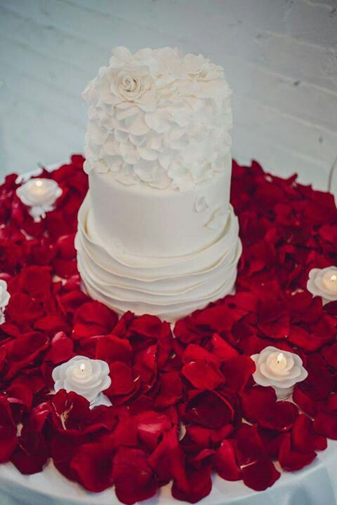 Velvety red rose petals frame this white cake with a splash of color. Fresh rose petals are available in a variety of colors year-round at GrowersBox.com!