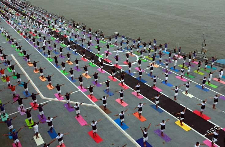 Members of the Indian Navy perform yoga on the flight deck of INS Viraat, an Indian Navy's decommissioned aircraft carrier during International Yoga Day in Mumbai, India, June 21, 2017. REUTERS/Danish Siddiqui