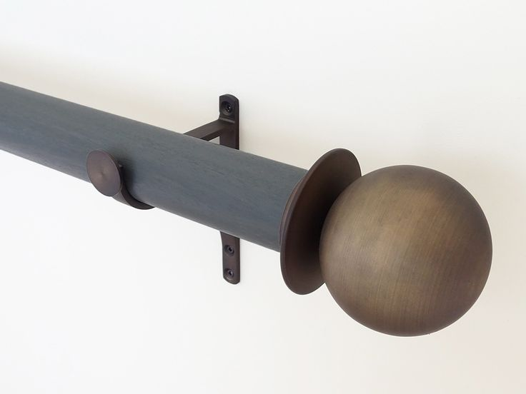 Stained wooden curtain pole with ball finials designed by Walcot House