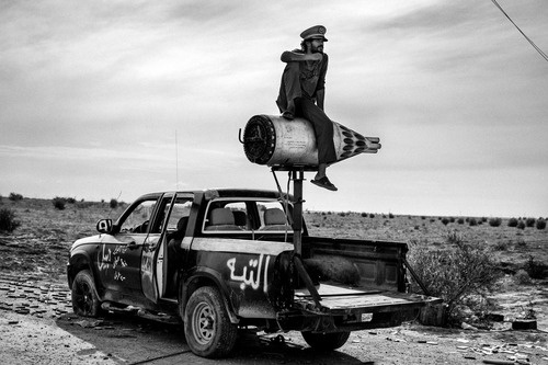 Portrait Salon 2012: a modern day salon des refusés. Above Sirte, October 2011. A revolutionary soldier sits on a rocket mounted on a pickup in the desert near Sirte, by Fabio Bucciarelli. (©Fabio Bucciarelli/Courtesy of Portrait Salon). Now in its second year, the Portrait Salon which forms a modern day salon des refusés of entries that did not get selected for the annual Taylor Wessing Photographic Portrait Prize exhibition, that is currently on show at London's National Portr... Read…
