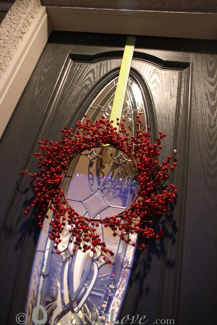 Definitely using this idea...How to hang a wreath on the front door 3M hook upside down ...