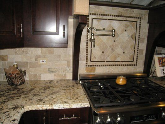 Like the tile but not the detail over the stove