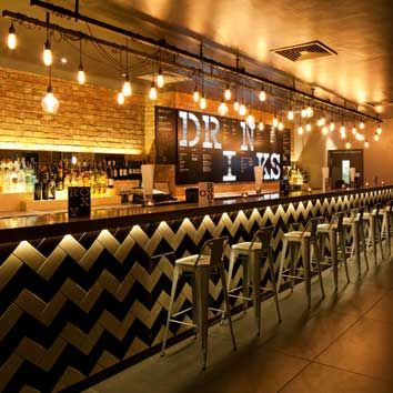The Roxy, London by designLSM - fabulous atmospheric bar interior.
