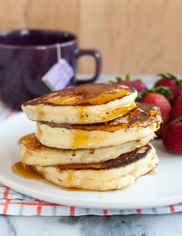 Extra-fluffy with creamy, custard-like middles — ricotta pancakes are something you need to try tout suite!