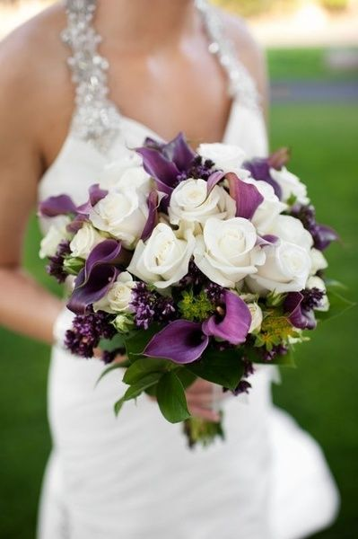 purple and ivory bouquet; purple cala lilies and ivory roses