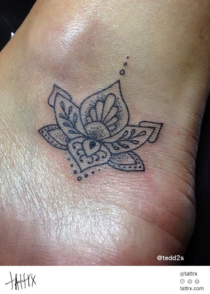 Tiny Lotus Flower This is it! The I'll-know-it-when-I-see-it tattoo. Boss!