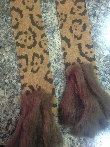 Cut out Cheetah Tails from felt cheetah print fabric.  Sew on fluffy part of tail using brown rovin (avail at craft stores)