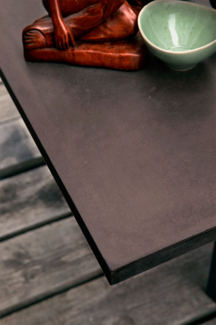Chocolate brown concrete table top. Design by Storm&Müller