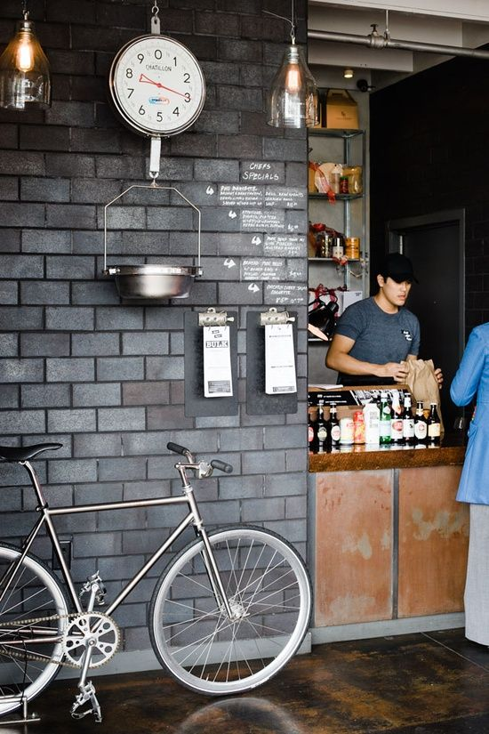 Stay-At-Home Bikes. Urban coffee shop style with grey stone wall great idea for street style cafe and bar