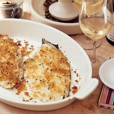 Baked Flounder with Parmesan Crumbs | Delicious baked flounder is one of the best fast fish recipes you can have in your repertoire. Chef Nigel Slater adds freshly grated Parmesan to the breadcrumbs to form a tasty buttery topping for the flaky white fish, which cooks in just 15 minutes.