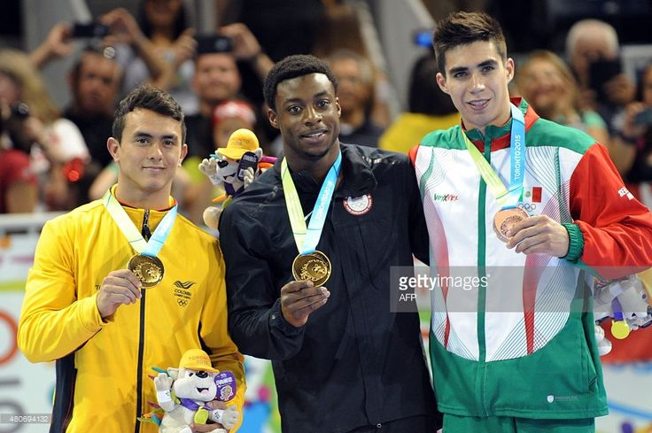 July 14 - Gymnastics Artistic - Men's - Pommel Horse. Marvin Kimble (C) of USA, gold; Colombian Jossimar Calvo (L), gold; and Mexican Daniel Corral (R), bronze, pose in the podium after the final of Men's Pommel Horse at the 2015 Pan American Games in Toronto, Canada, on July 14, 2015. AFP PHOTO/HECTOR RETAMAL