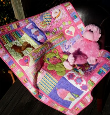 A throw quilt made from individual blocks pieced together in rows...