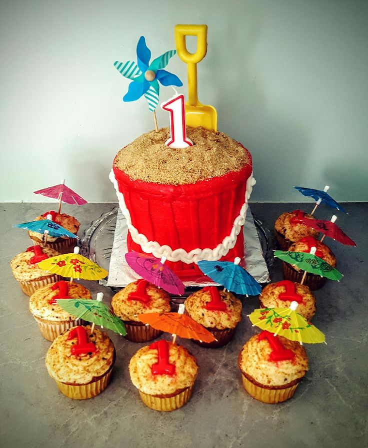 Sand bucket cake and cupcakes.