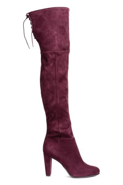 Knee-high imitation suede boots with covered heels, lacing at the top and a short zip at the bottom. Jersey insoles and linings and rubber soles. Heel 9.5 c
