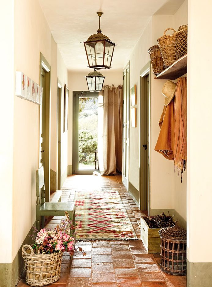 Warm and inviting foyer. In case anyone wants to know why there are curtains at the door - I had them in Italy, for the cold months the drapes would be closed to keep drafts out when opening the door...and they worked very well.