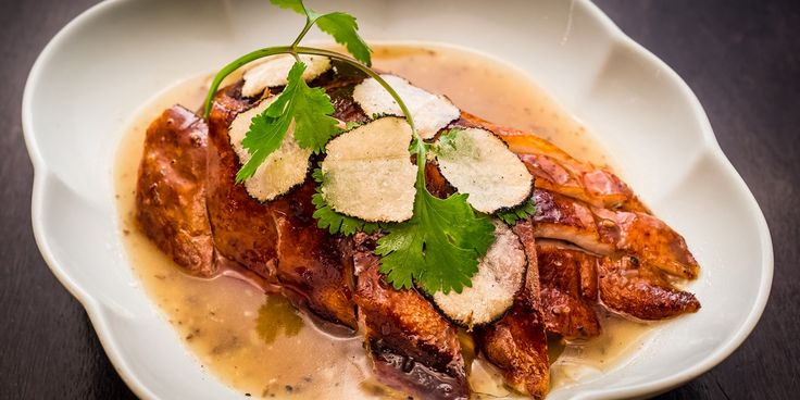 A stunning Chinese duck recipe from Tong Chee Hwee, where roasted duck is served alongside a luxurious truffle sauce