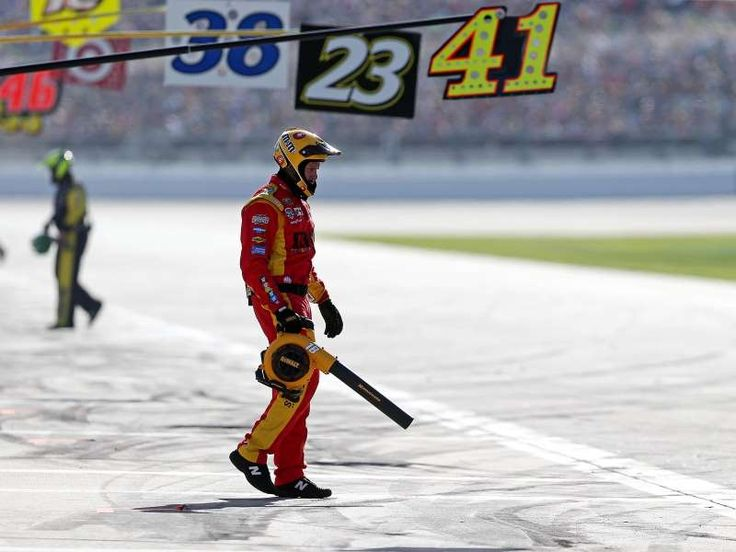 Best of the 2016 Daytona 500:     Pit crew members blow off the pit boxes.