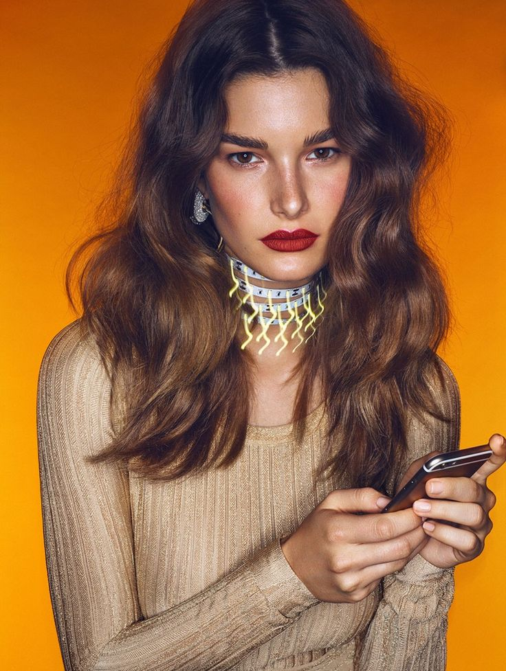 The brunette model serves major beauty inspiration with pumped up waves and red lipstick for Vogue Mexico Magazine July 2016 issue