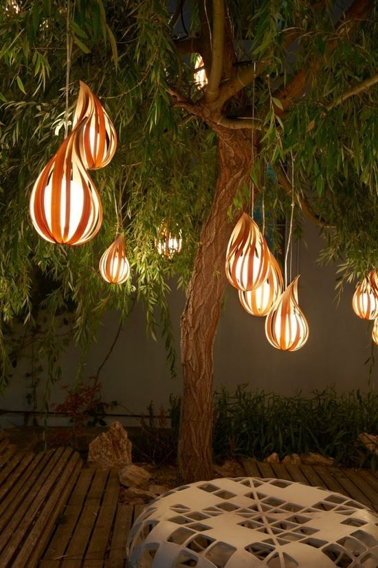"""Indoor tree with lanterns for the """"city center"""" feel around the kitchen w/ dining tables."""