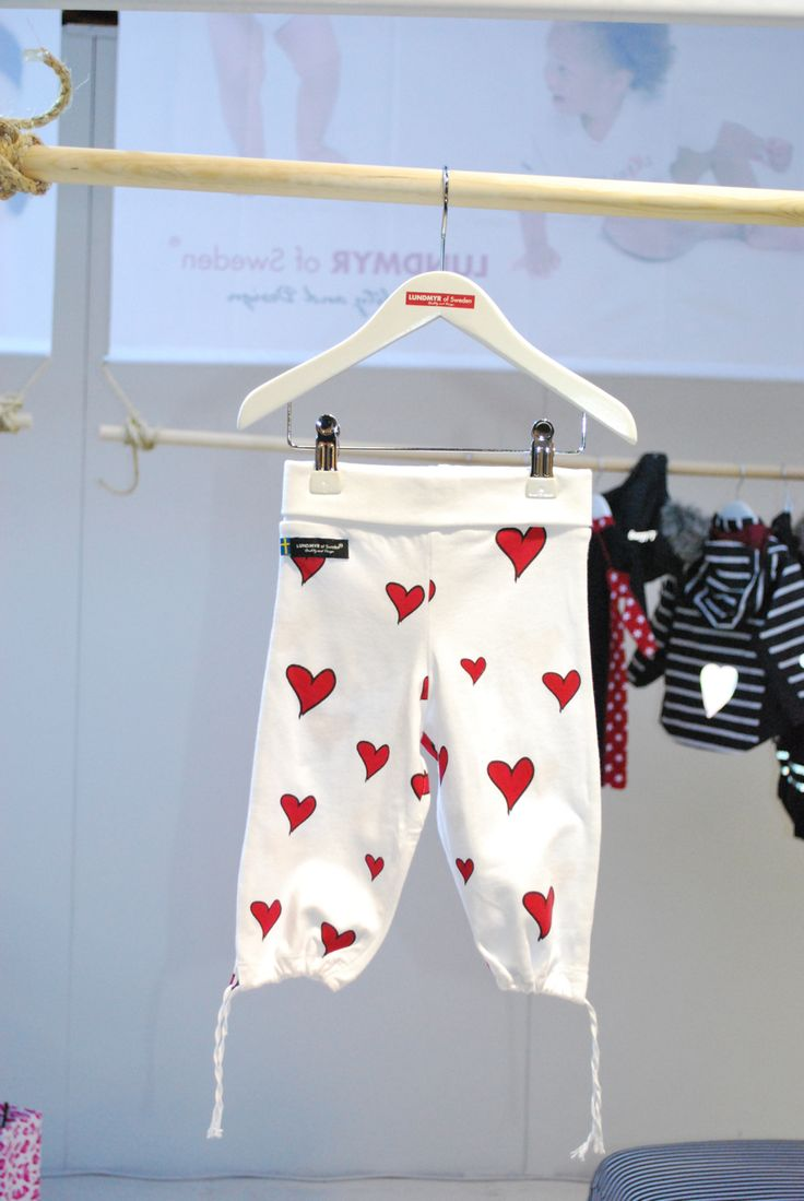 White cotton tricot pants with red hearts. Available in size 0-2 years.