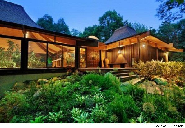 One of Frank Lloyd Wright's apprentices designed this architectural masterpiece. Comprised of three interconnected, glass-encased pods, the home boasts a one-of-a-kind patented double-story roof. More photos and info http://aol.it/xe8Qe2